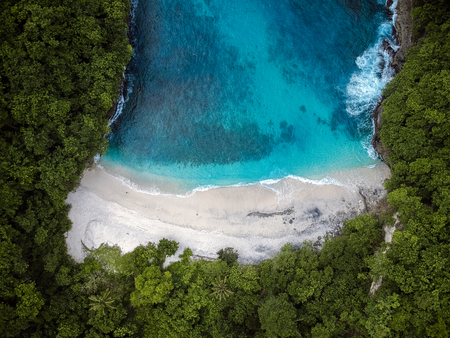 beautiful secluded beach with blue sea.the view from the top Archivio Fotografico