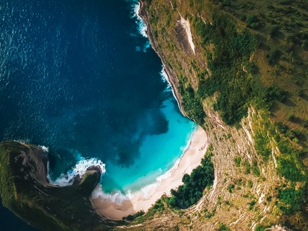 stunning ,secluded beach surrounded by mountains ,the view from the top