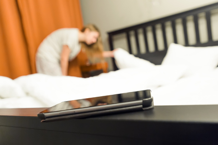 Women try to find a phone at bedroom.