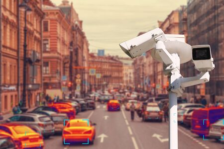 The concept of video surveillance and security technology. The surveillance camera tracks violators of traffic rules during traffic congestion. Definition zone.