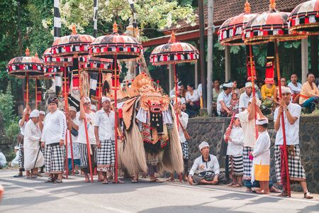 Galungan Holiday. Festive procession in anticipation of the Barong dance. Bali Island, Indonesia. 26.12.2018