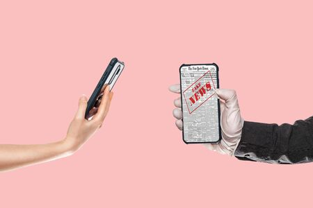 A man in a black shirt and medical gloves holds a smartphone with fake news. On the left, a woman's hand substitutes a smartphone. Pink background.The concept of disinformation and false news on the Internet.