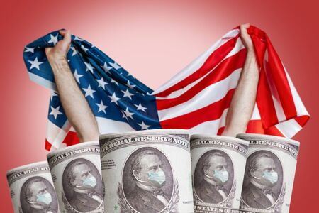 Banknotes with the image of the President in a medical mask on the background of the American flag. Copy space. The concept of the financial crisis, and viral pandemics.