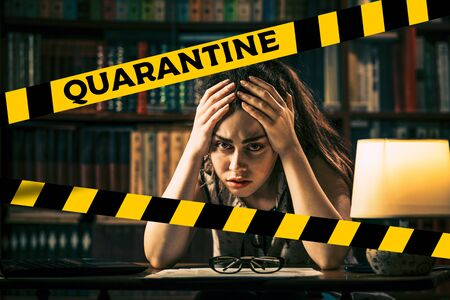 Do not cross.Barrier tape-quarantine,isolation.A young woman clutches her head with her hands from stress.The concept of quarantine and remote work.