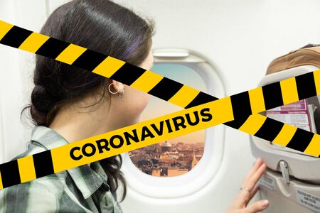 Do not cross.Barrier tape-quarantine,isolation.A woman looks out of the plane window at the city. The concept of quarantine, and isolation coronavirus. Standard-Bild