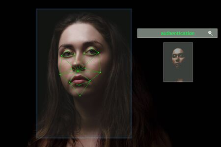 identification of the young girl's face by the security system .security concept. Reklamní fotografie