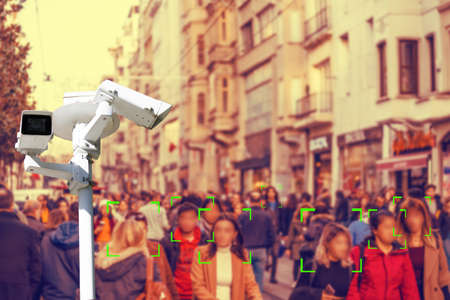 CTV. Crowds of people walking down the street. Identification of persons. Concept of modern video surveillance technologies.