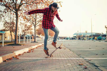 Skateboarding. A man does an Ollie stunt on a skateboard. Jump in the air.