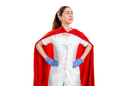 A doctor wearing a medical gloves, and a superhero red cape stands guard over health. Isolated on white background. The concept of the Power of a super hero for medicine.