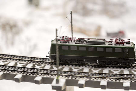 Layout of the city and small figures. Train rides by rail, winter landscape.