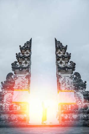 Silhouette of woman standing at sunlight. Lempuyang Temple, Bali Indonesia.