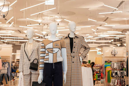 Female mannequins advertising a new collection of clothing. Women's clothing store. The concept of consumerism.