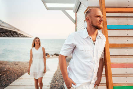 Dating at beach. Handsome Caucasian man waiting his girlfriend. Romance vacation.