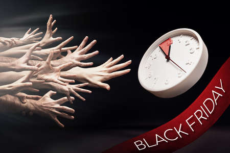 Start of sales. Many hands reach for the clock. Black background. The concept of Black Friday, Cyber Monday and discount. Standard-Bild