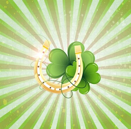 golden horseshoe: Golden horseshoe and clover on a striped background. St. Patricks Day symbol