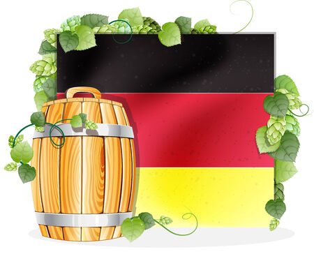 oak barrel: Oak wooden beer barrel on the background of the German flag, decorated with green hops
