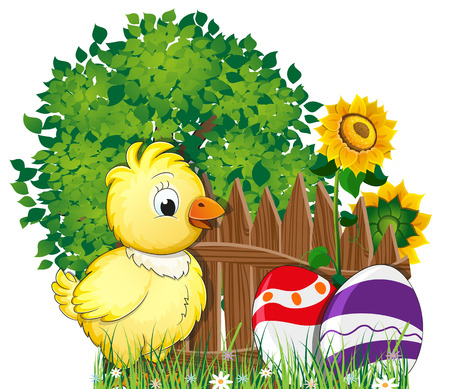 Little fluffy chicken and painted Easter eggs in the meadow with flowers near a tree