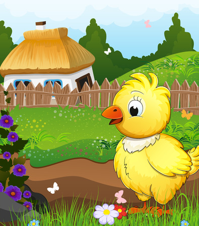Little chicken on a green meadow in front of a farmhouse with a thatched roof. Rural landscape