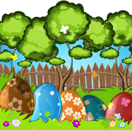 rural scene: Painted Easter eggs in the grass on a green meadow. Green trees near a wooden fence in the background.  Easter scene rural