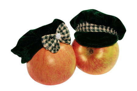 The juicy appetizing motley red apple has dressed a female and mans hats.  marital pair photo