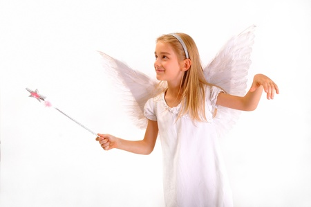 A little girl dressed as an angel with a magic wand.Isolated on white background. Stock Photo - 18202967