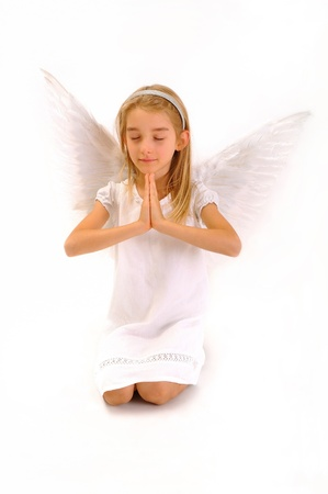 Angel who prays.Little girl , depicts an angel who prays.Isolated on white background. Stock Photo - 18202936