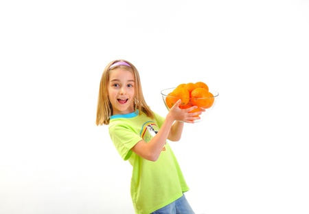 Smiling girl with oranges photo