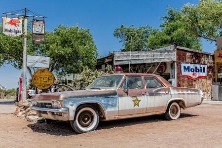 general store: Hackberry, Arizona, USA - June 11th 2014. Rusty wreck of an old sheriffs car at Hackberry General Store. Hackberry is located on Arizona State Route 66 (former U.S. Route 66) 23 miles northeast of Kingman
