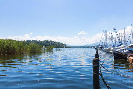 landing stage: Lake Chiemsee, Bavaria, Germany - August 7th, 2016. Several sailing boats at a landing stage in Breitbrunn.