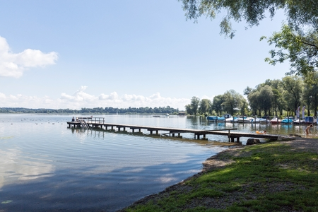 landing stage: Lake Chiemsee, Bavaria, Germany - August 7th, 2016. Landing stage and beach in Rimsting.