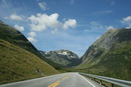 a road throw the beautiful norwegian mountains photo
