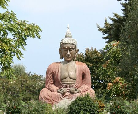 Buddha e la postura seduta di Meditazione  Archivio Fotografico