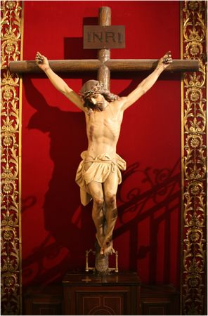 jesus on a cross over the red background Stock Photo