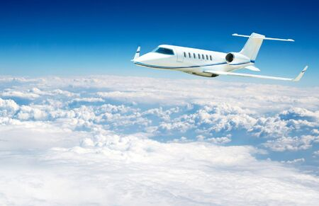 airplane fliying on the beautiful blue sky background Stock Photo