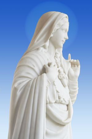 beatiful white statue of Virgin Mary on blue background Stock Photo - 965356