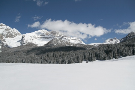 Snow scene panorama of winter mountains photo