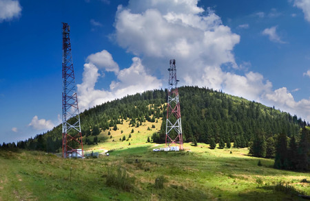 Mountain landscape with amplification towers and antennas - mobile