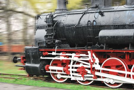 The old - fashioned steam locomotive running Stock Photo