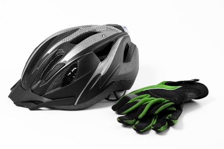 mountain bicycling: bicycle helmet and gloves on a white background