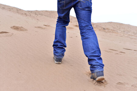hiker foot walking in sand  Stock Photo