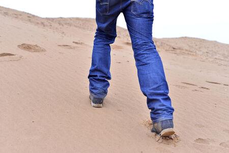hiker foot walking in sand  Stock Photo