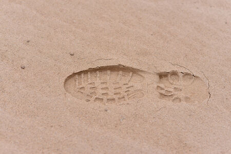 Human footsteps in the sand Stock Photo