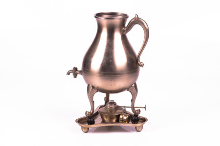 Antique russian samovar over white background