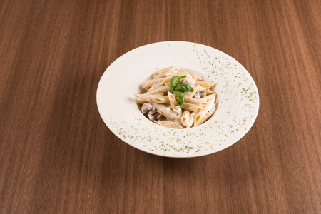 traditional italian pasta with mushrooms and gorgonzola sausages