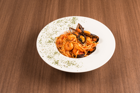 traditional italian pasta with shells on a white dish