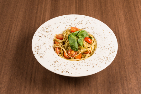 simple italian pasta with cherry tomatoes on a white dish