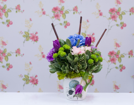 Flowers arrangement with roses, hortensia and tulips