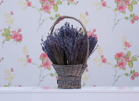 Bunches of lavender flowers in a wicker basket
