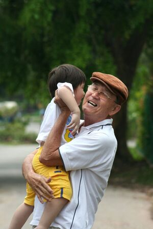 dad/grandfather carrying son/grandson for a walk Stock Photo - 436638