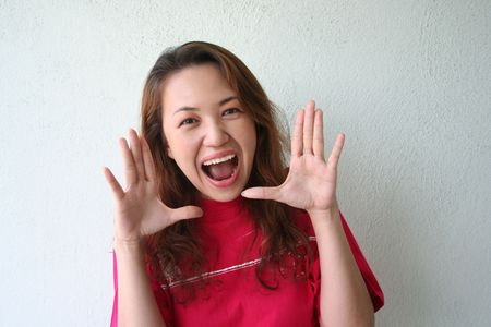 hurray: woman with shouting expression Stock Photo
